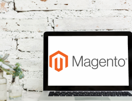 laptop with magento's logo on it