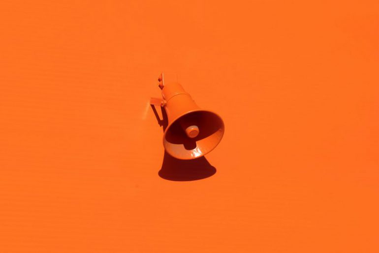 speaker on a wall colored orange
