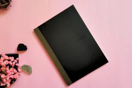 notebook on a pink background