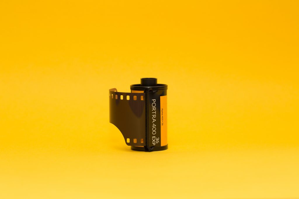a film tape on a yellow background