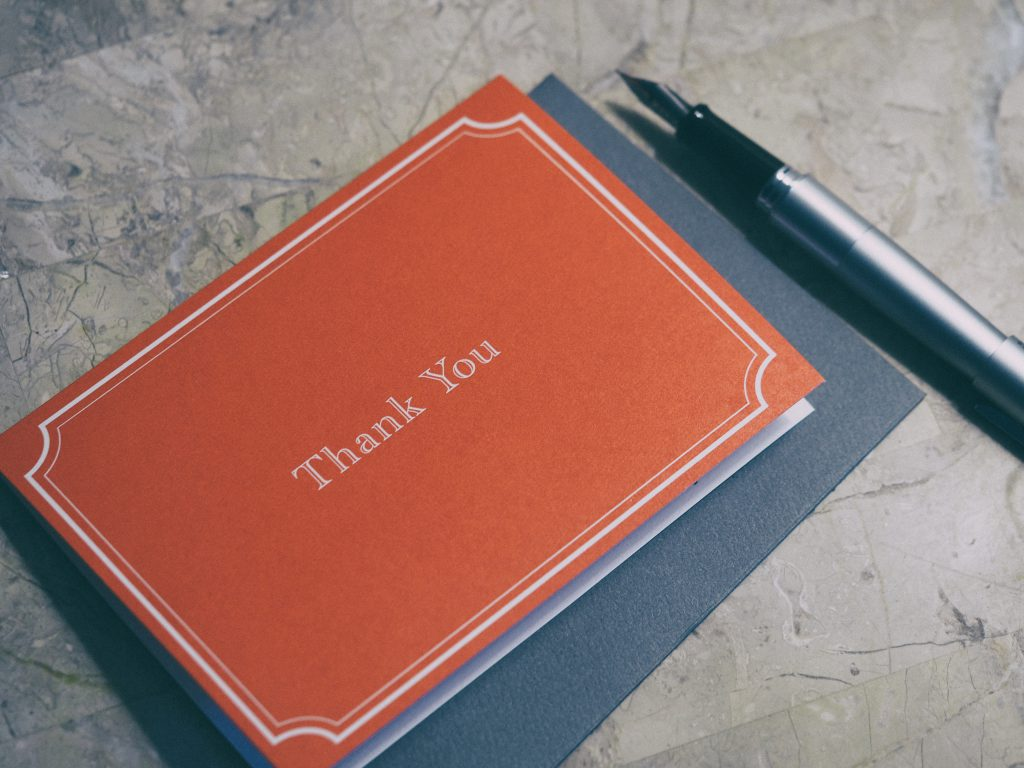 a red thank you card