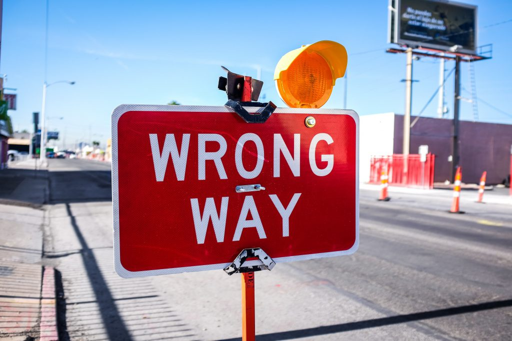 street sign that says wrong way symbolising what to avoid when writing product description