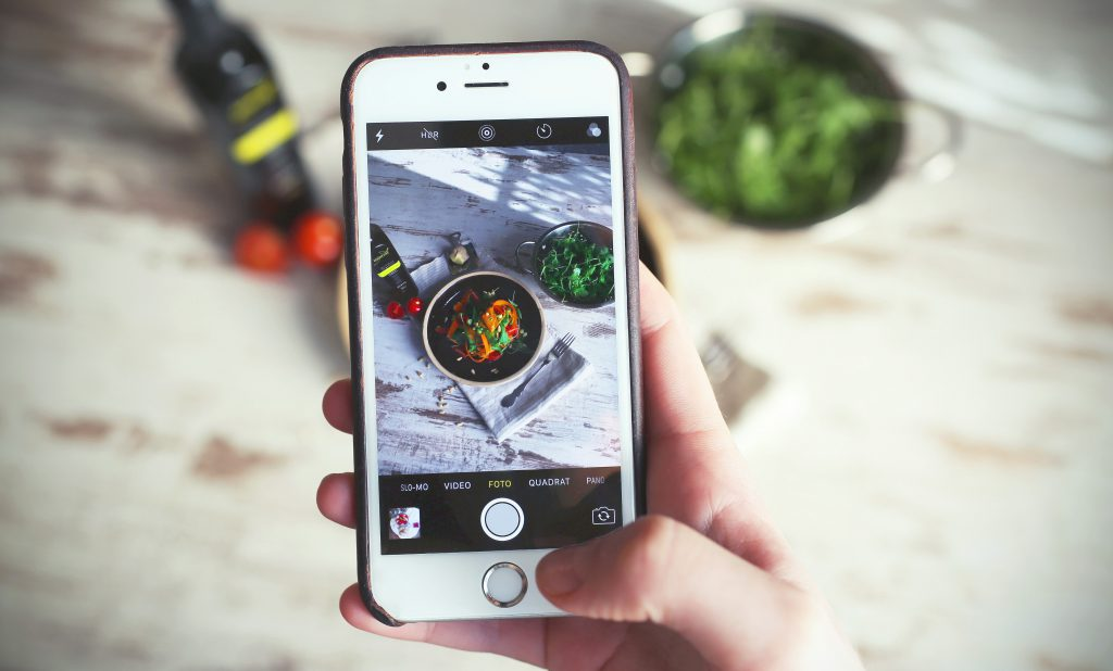 someone taking picture of food