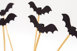black bats on a stick