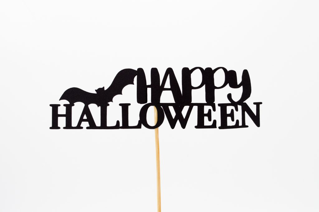 happy halloween written in black on a stick
