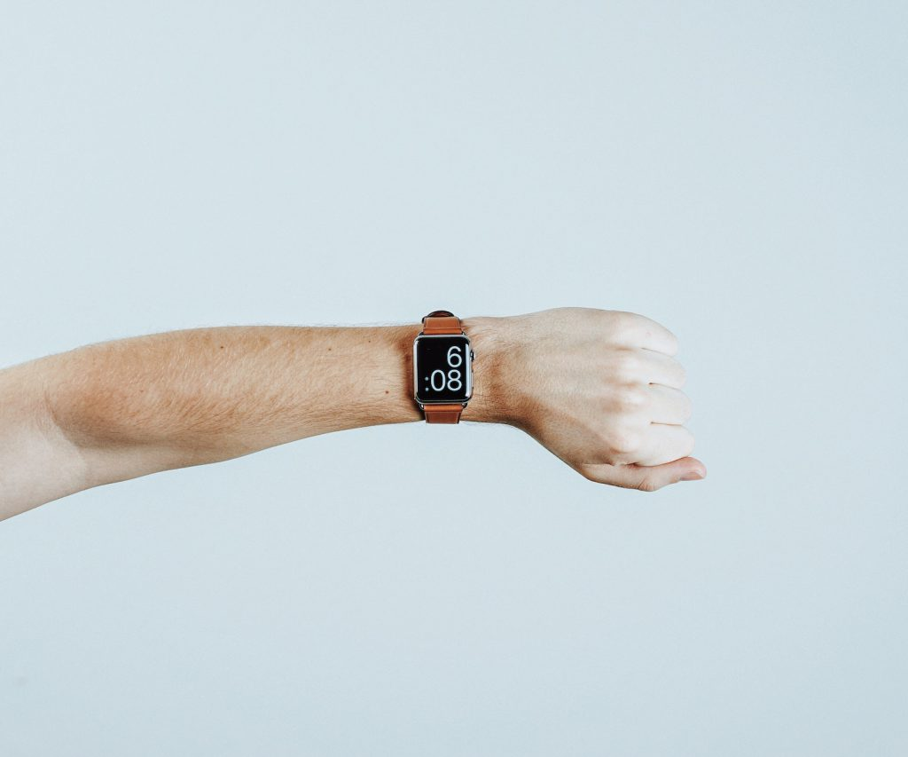 hand with a watch on it representing saving time with product management