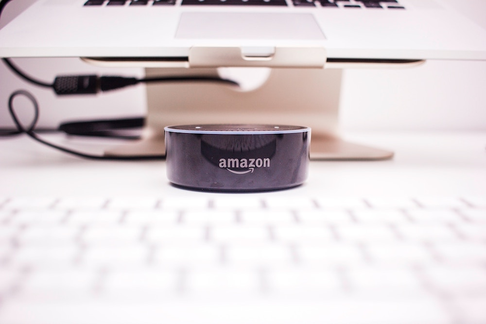 amazon device in front of a computer which represents amazonbasics