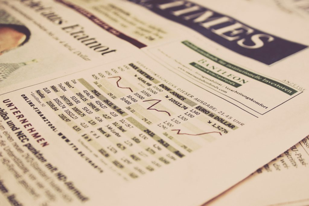 economy analytics on a newspaper