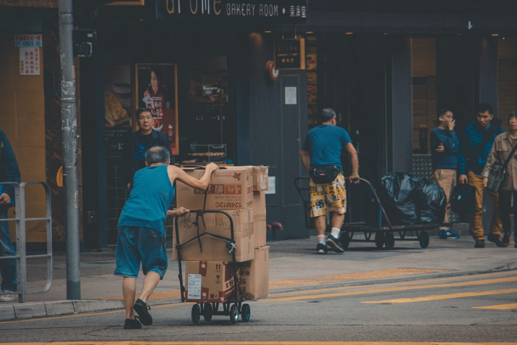 person pushing a delivery car